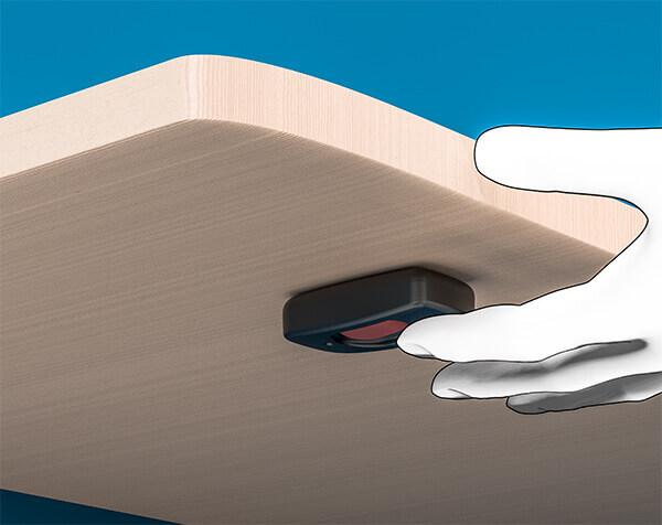 noodknop onder tafel